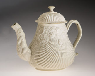 Saltglaze teapot, pectin moulded with dolphins & grotesques, c.1755 -0