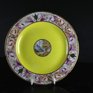 Coalport plate, London decorated with scene, yellow ground, classical busts, c.1805 -0