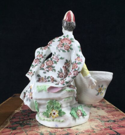 Meissen figure of a seated Turk lady, by J.F.Eberlein, c. 1750, later decorated. -16567