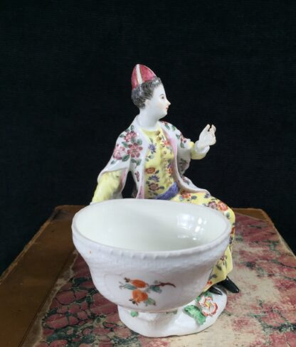 Meissen figure of a seated Turk lady, by J.F.Eberlein, c. 1750, later decorated. -16568