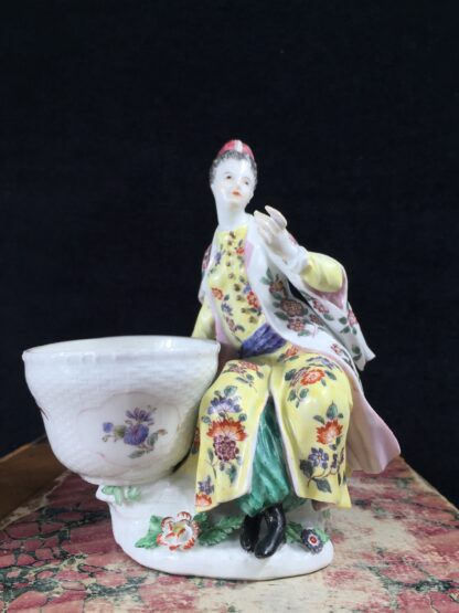 Meissen figure of a seated Turk lady, by J.F.Eberlein, c. 1750, later decorated. -16569