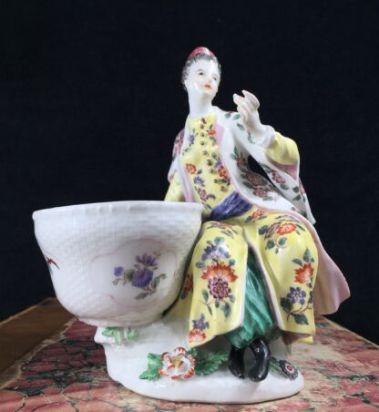 Meissen figure of a seated Turk lady, by J.F.Eberlein, c. 1750, later decorated. -16574