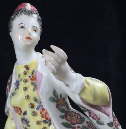 Meissen figure of a seated Turk lady, by J.F.Eberlein, c. 1750, later decorated. -16575