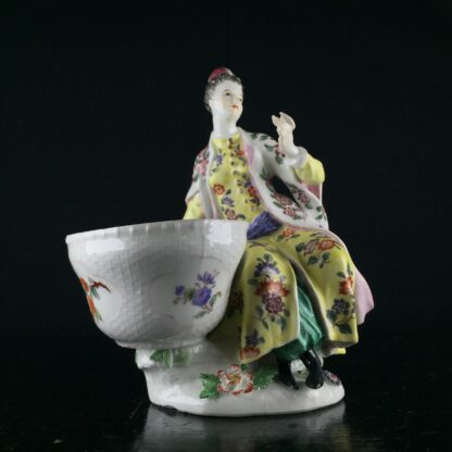 Meissen figure of a seated Turk lady, by J.F.Eberlein, c. 1750, later decorated. -0