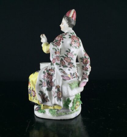 Meissen figure of a seated Turk lady, by J.F.Eberlein, c. 1750, later decorated. -9709