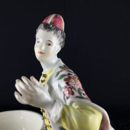 Meissen figure of a seated Turk lady, by J.F.Eberlein, c. 1750, later decorated. -9711