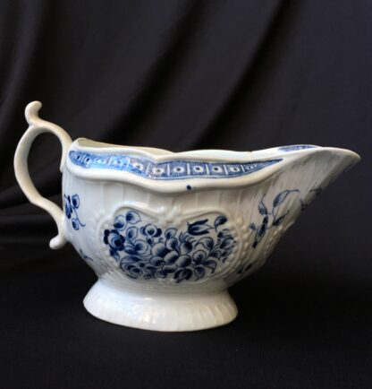 Caughley sauceboat, rib moulded with underglaze blue flower groups, c. 1780 -0