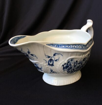 Caughley sauceboat, rib moulded with underglaze blue flower groups, c. 1780 -19838