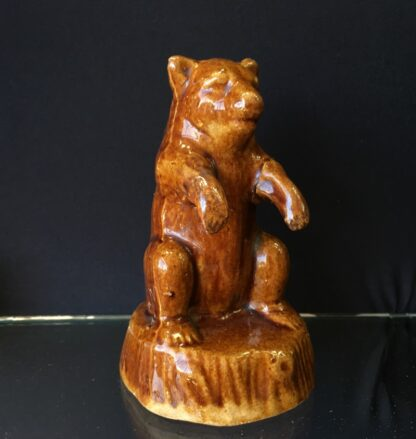 Bear shaped brown glazed pottery money box, 19th C. -23859