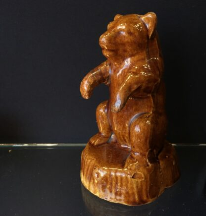 Bear shaped brown glazed pottery money box, 19th C. -23861