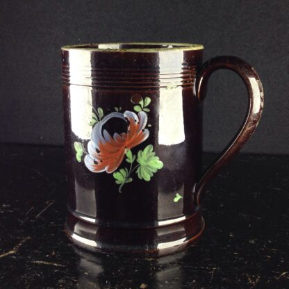 Jackfield type mug with fired enamel flowers, c. 1780 -0