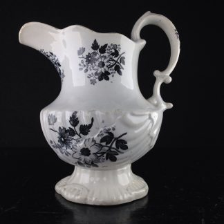 Black printed jug, shell moulded, possibly Welsh C. 1835. -0
