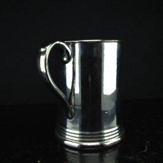 Silver lustre tankard of metal form, C. 1820. -0