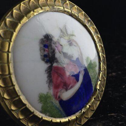 English enamel curtain tie-back, girl with bird, c. 1780. -4876