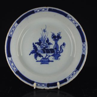 Liverpool delft plate, Chinese 'precious objects', c. 1760. -0