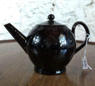 Jackfield type teapot, ghost of flowers, C. 1760-0