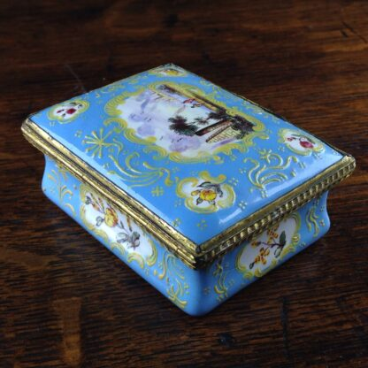 South Staffordshire enamel snuff box, pale blue ground with panels of scenes and flowers, c.1765 -5037