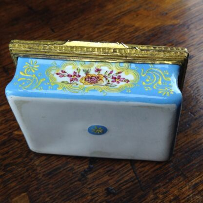 South Staffordshire enamel snuff box, pale blue ground with panels of scenes and flowers, c.1765 -5038
