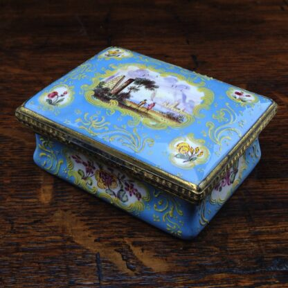 South Staffordshire enamel snuff box, pale blue ground with panels of scenes and flowers, c.1765 -0