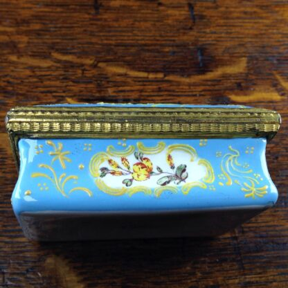 South Staffordshire enamel snuff box, pale blue ground with panels of scenes and flowers, c.1765 -5043