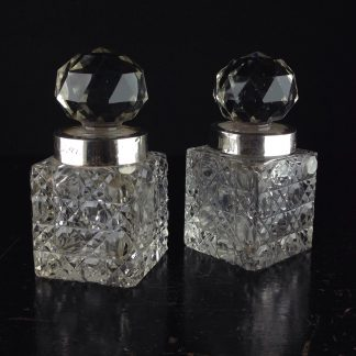 Pair of hobnail cut crystal perfume dressing table bottles, silver mounts London 1899-0