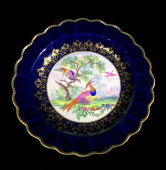 Worcester plate with gros blue ground, exotic birds in landscape, c. 1775-0