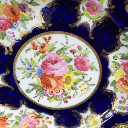 Coalport blue ground plate, superb flower panels, c. 1815 -13130