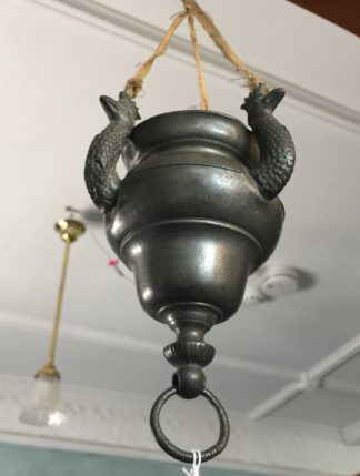 Continental pewter 'eternal flame' lamp with crowned peacock heads, early 19th century-0