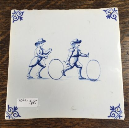 Dutch Delft tile with boys & hoops, 20th century-0