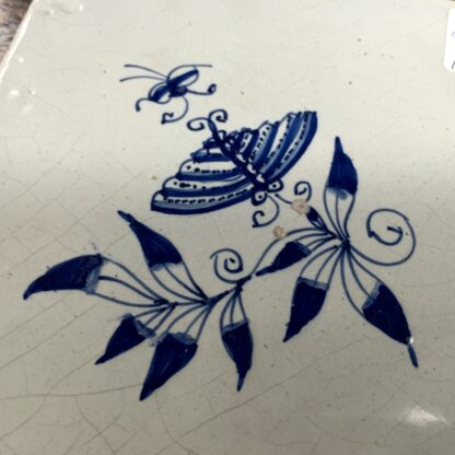 Dutch Delft tile with a butterfly & flower, c.1700-11876