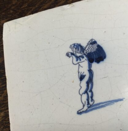 Dutch Delft tile with a cherub, c.1700-11878