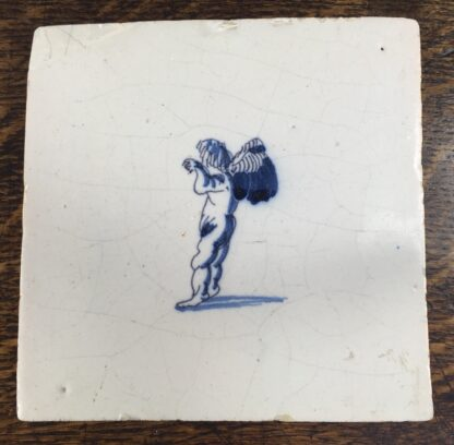 Dutch Delft tile with a cherub, c.1700-0