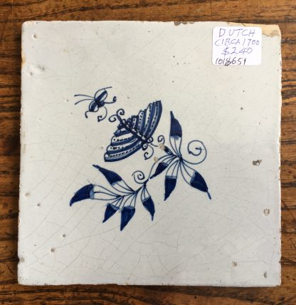 Dutch Delft tile with a butterfly & flower, c.1700-0