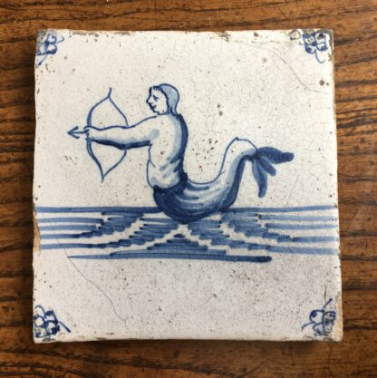 Dutch Delft tile with rare depiction of a merman archer, c.1700-20056