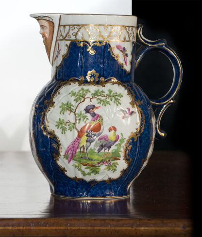 Worcester mask jug with scale blue ground, exotic birds, c. 1775-15823