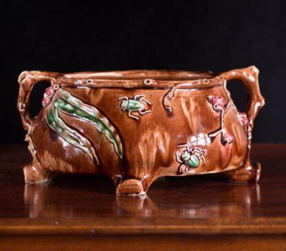 Clem Ainslie, Harvey School Australian Pottery jardinier, gum leaves & beetles, 1936-0