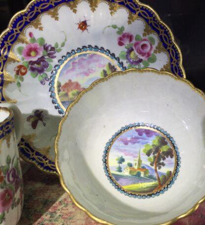 Worcester trio, 'Dalhousie' pattern with flowers. c1785-15685
