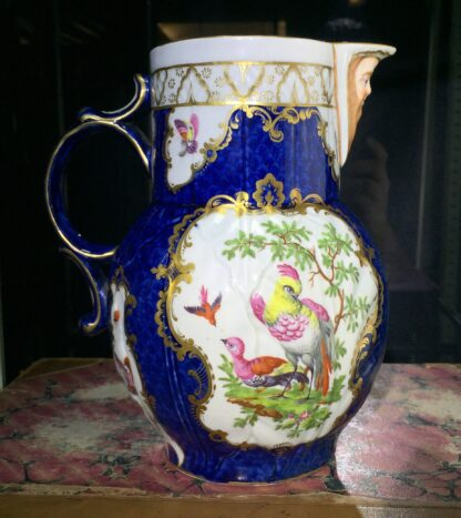 Worcester mask jug with scale blue ground, exotic birds, c. 1775-15774
