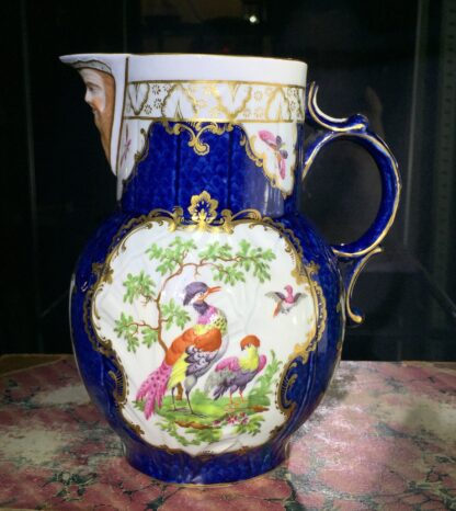 Worcester mask jug with scale blue ground, exotic birds, c. 1775-0