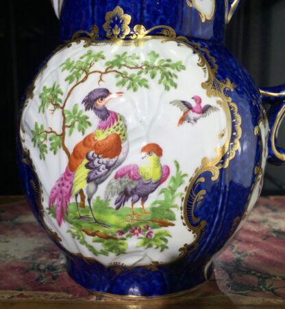 Worcester mask jug with scale blue ground, exotic birds, c. 1775-15781