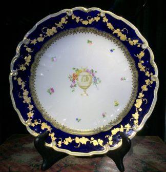 Chelsea-Derby plate, mazarine blue ground & classical urn, c.1775-0