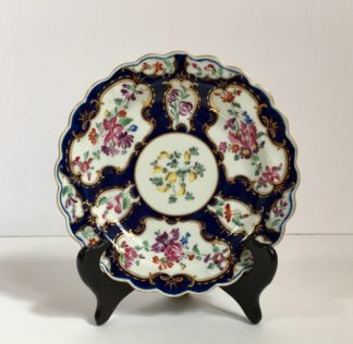 Small Worcester plate, scale blue with James Giles flower panels, c. 1765-0