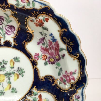 Small Worcester plate, scale blue with James Giles flower panels, c. 1765-23017