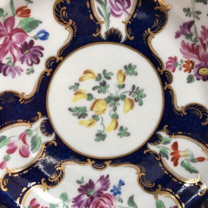 Small Worcester plate, scale blue with James Giles flower panels, c. 1765-23018