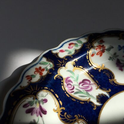 Small Worcester plate, scale blue with James Giles flower panels, c. 1765-23023
