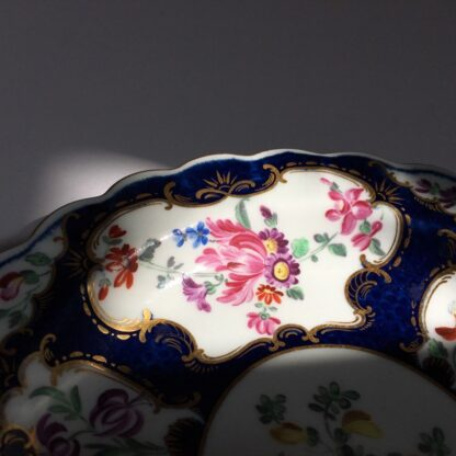 Small Worcester plate, scale blue with James Giles flower panels, c. 1765-23019