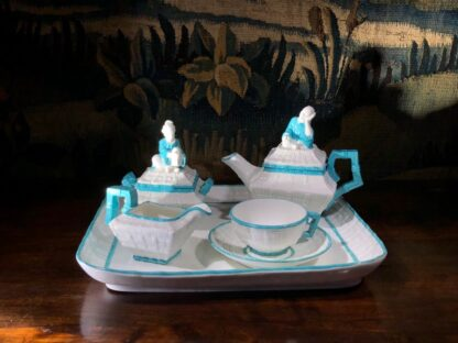 Porcelain cabaret set by T Ford moulded as baskets with Chinamen as handles, c. 1875 -32472