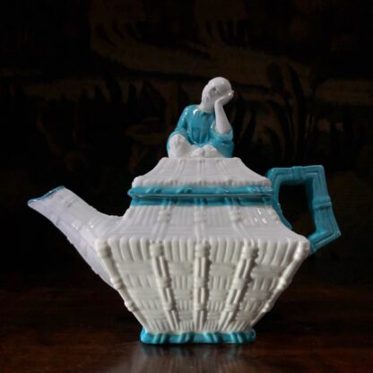 Porcelain cabaret set by T Ford moulded as baskets with Chinamen as handles, c. 1875 -32474