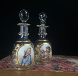 Pair of perfume bottles, hand painted child portraits, c. 1880-0