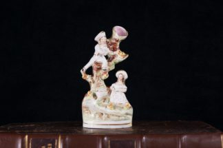 Staffordshire pottery figural spill vase, birdnesters, c.1860-0